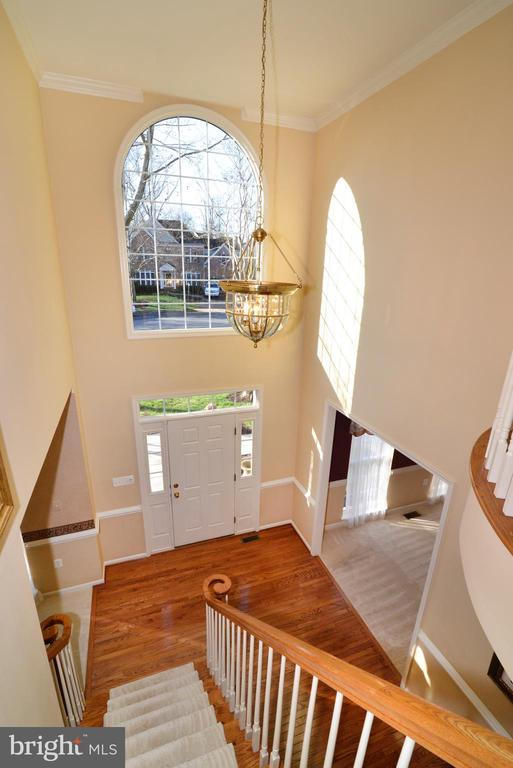 Light filled foyer; hardwood stairs - 1439 HARLE PL SW, LEESBURG