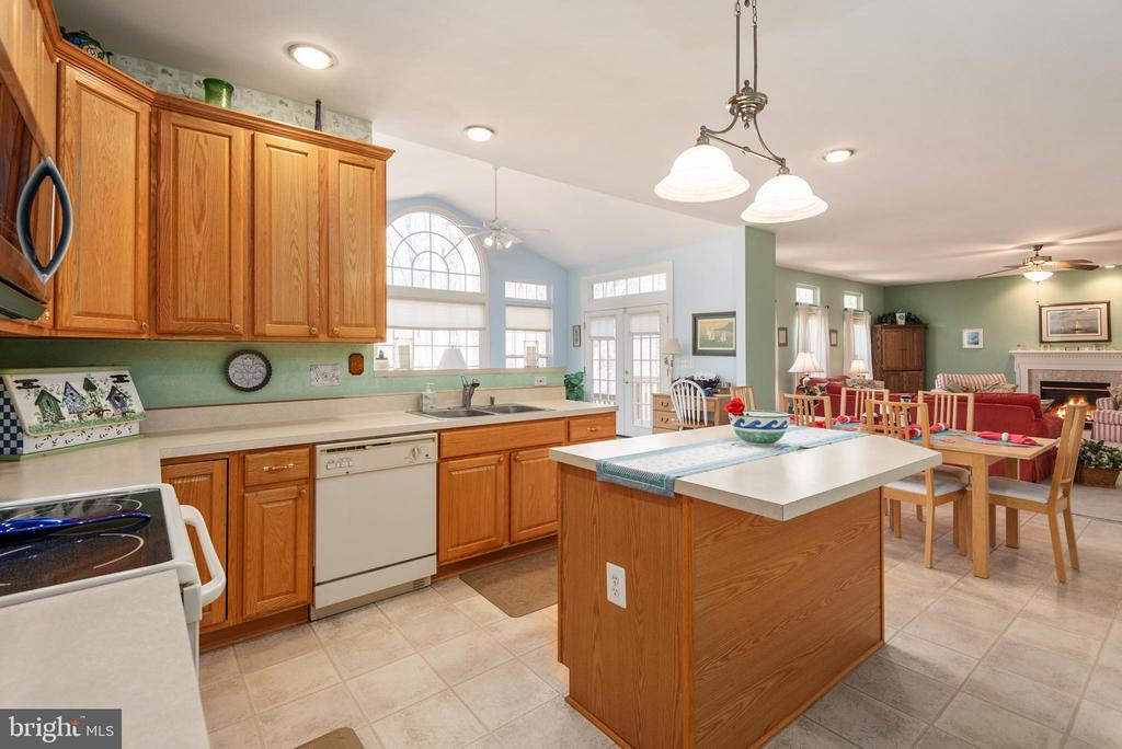 Kitchen features ample cabinetry & island - 28 FIREBERRY BLVD, STAFFORD