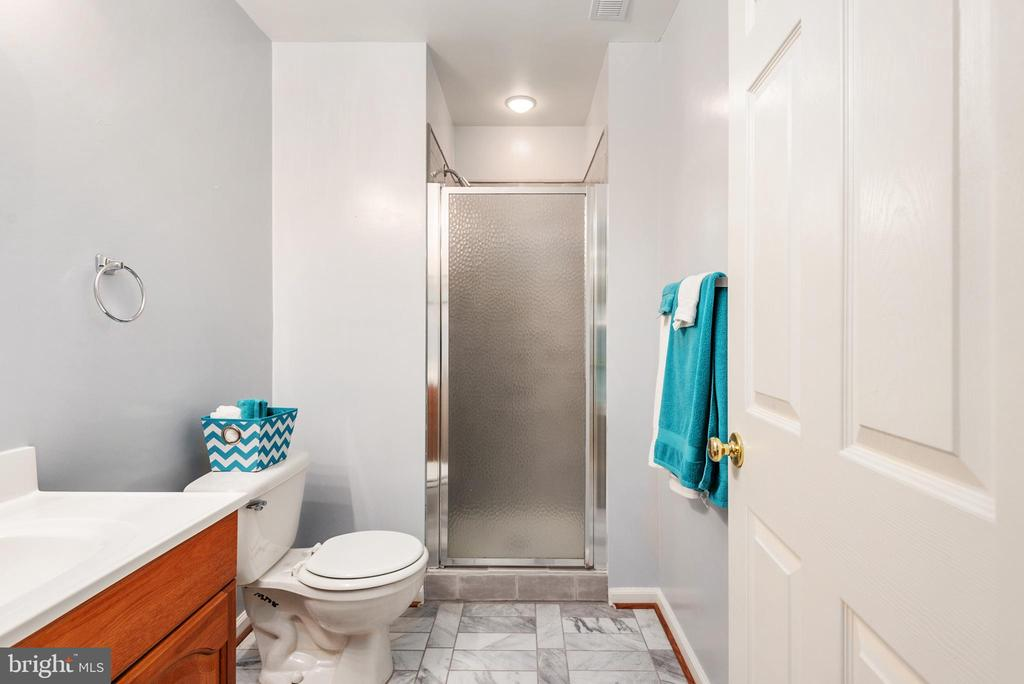 Remodeled full basement bathroom - 28 FIREBERRY BLVD, STAFFORD