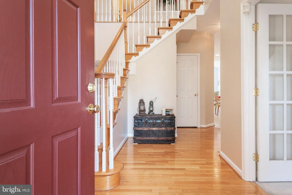 Open foyer with wood flooring and stairs. - 28 FIREBERRY BLVD, STAFFORD
