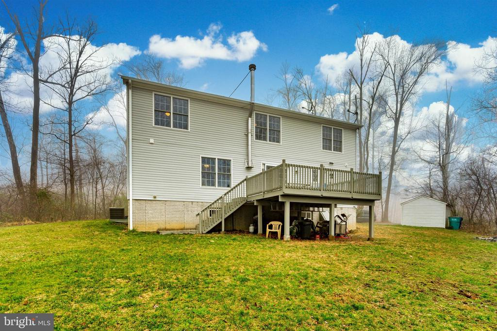 Back yard - surrounded by wooded acreage - 8354 HORNETS NEST RD, EMMITSBURG