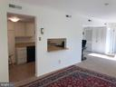 Kitchen with pass-through to Living Room - 1300 ARMY NAVY DR #1012, ARLINGTON
