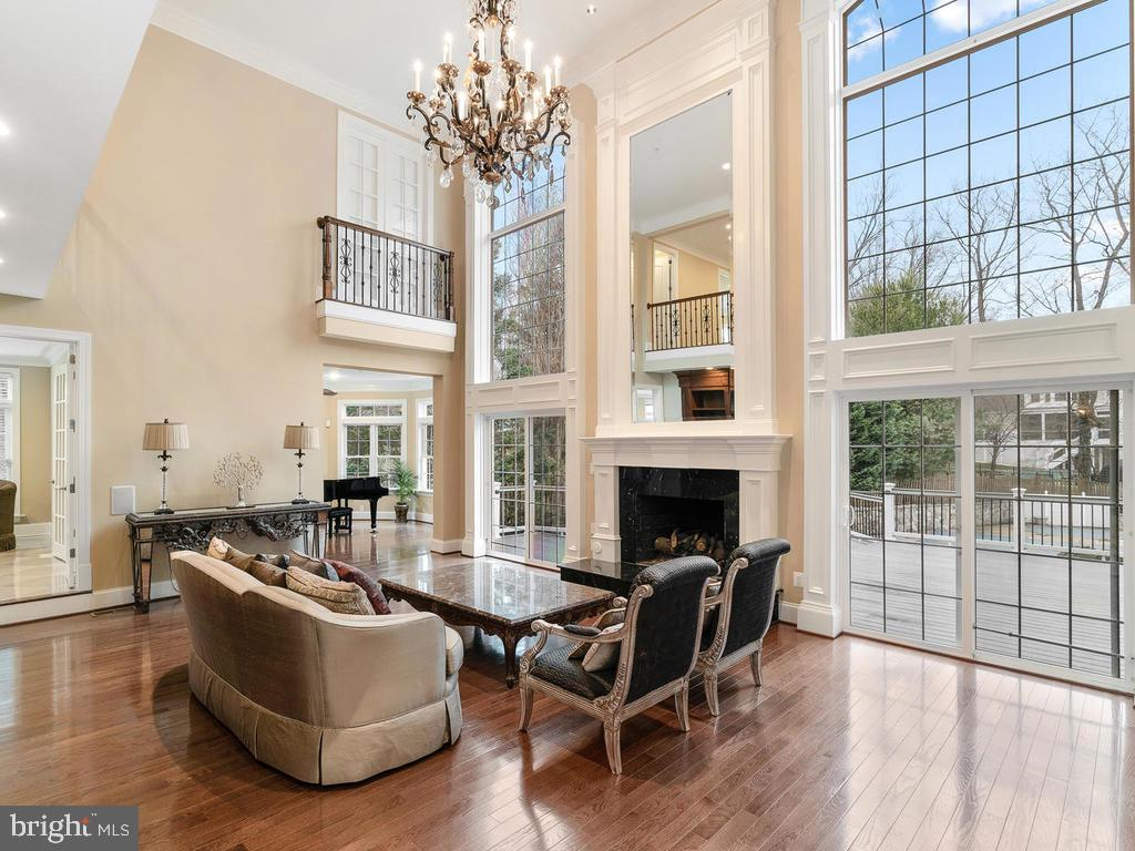 FAMILY ROOM WITH CUSTOM FIREPLACE + CHANDELIER - 10801 WINDCLOUD CT, OAKTON