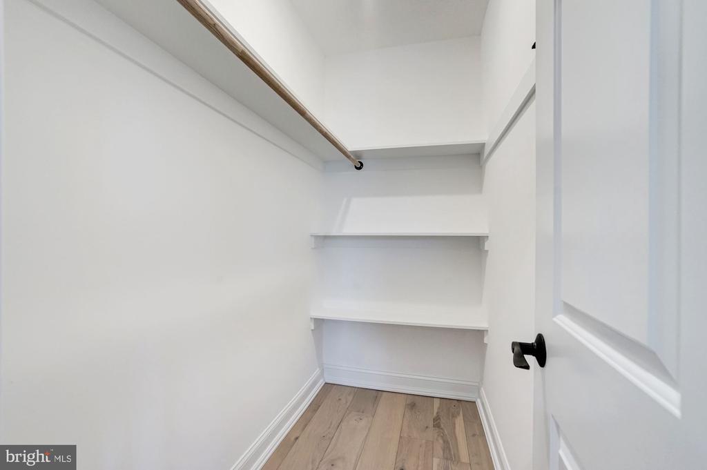 Walk-In Closet in Master Bedroom - 207 VARNUM ST NW, WASHINGTON