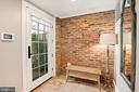 Side  entry with reclaimed brick accent - 320 N PATRICK ST, ALEXANDRIA