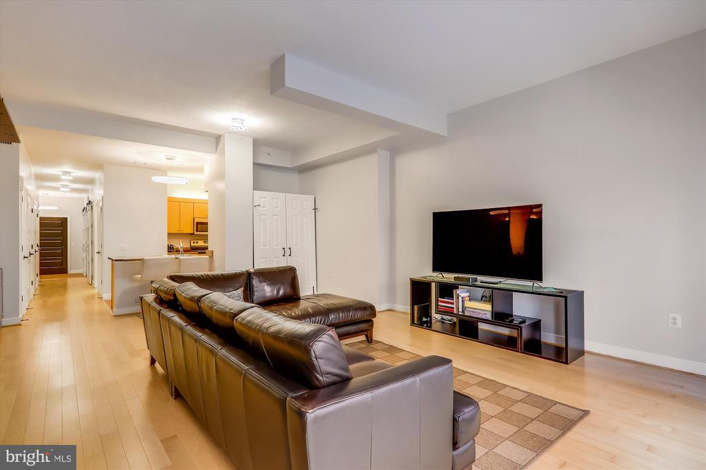Living area opens to kitchen - 631 D ST NW #129, WASHINGTON
