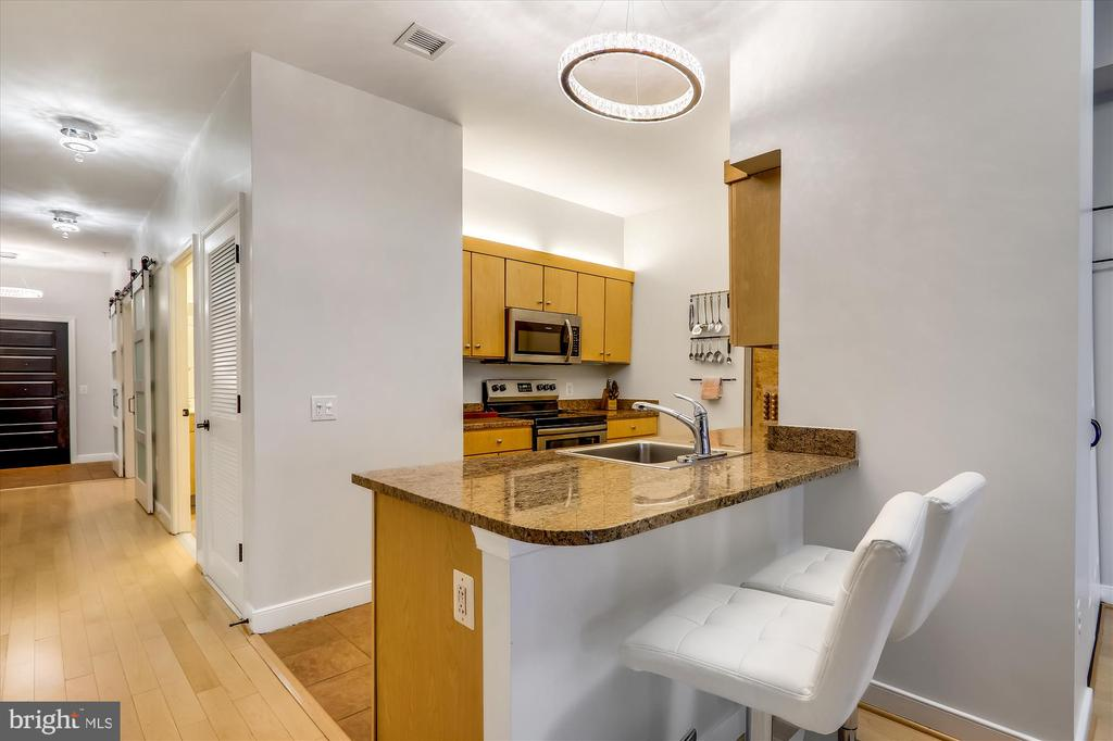 Kitchen with stainless steel appliances - 631 D ST NW #129, WASHINGTON