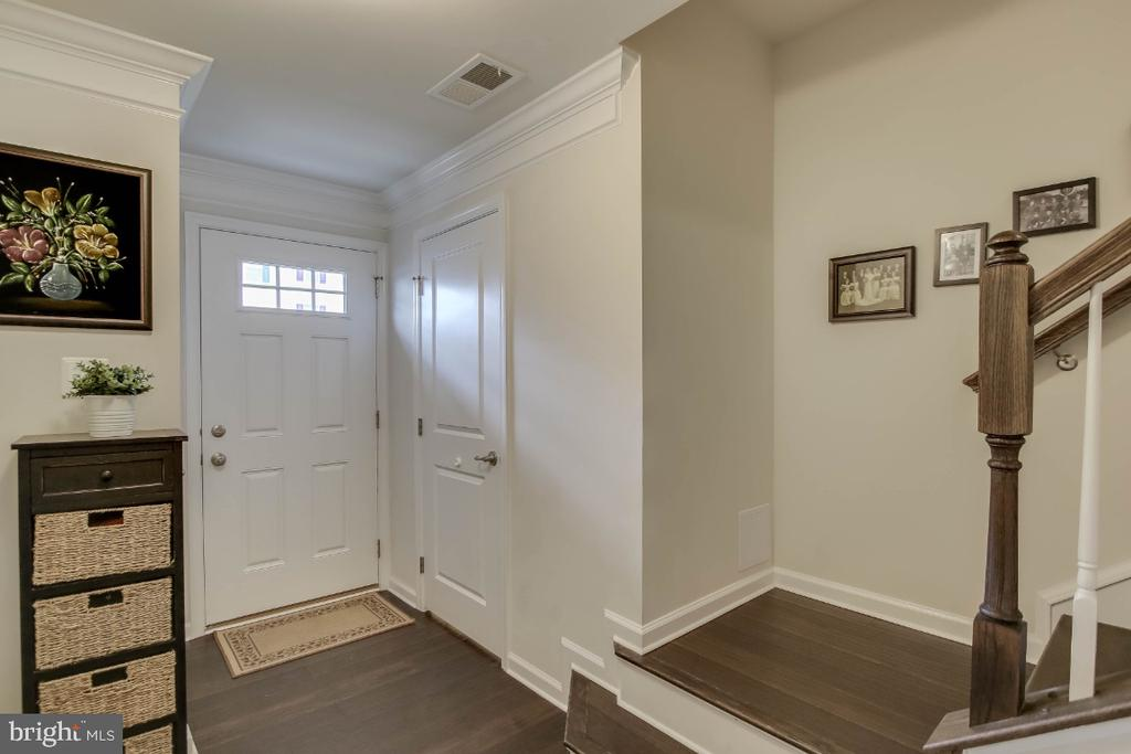 Welcoming entryway flanked by half bath, closet - 5812 ROCHEFORT ST, IJAMSVILLE