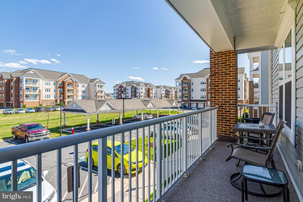 One of two beautiful balconies. - 20570 HOPE SPRING TER #205, ASHBURN