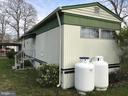Rear View  with new propane tanks - 3417 DAHLIA LN, MIDDLE RIVER