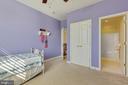 Bedroom 1 with full bath - 20240 MCNAMARA RD, POOLESVILLE
