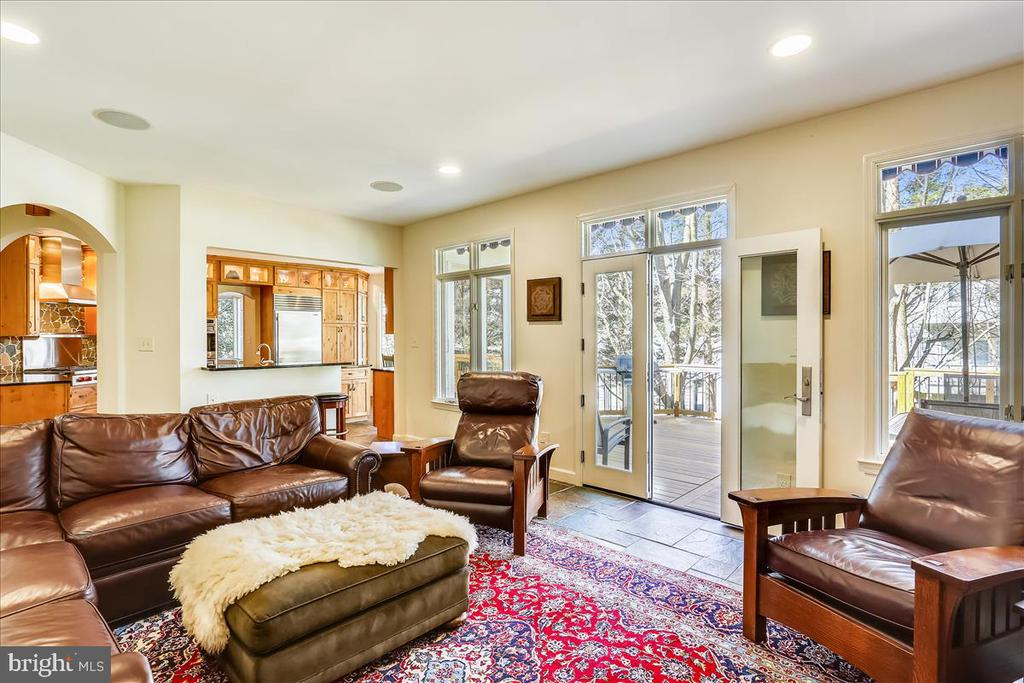 Family Room with doors to Rear Deck - 6308 MOUNTAIN BRANCH CT, BETHESDA
