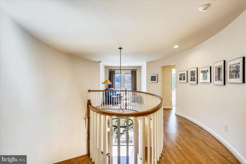 Upper Level Hallway and Curved Staircase - 6308 MOUNTAIN BRANCH CT, BETHESDA