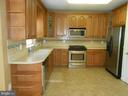 Corian Counters - Upgraded Cabinets - 8866 MOAT CROSSING PL, BRISTOW