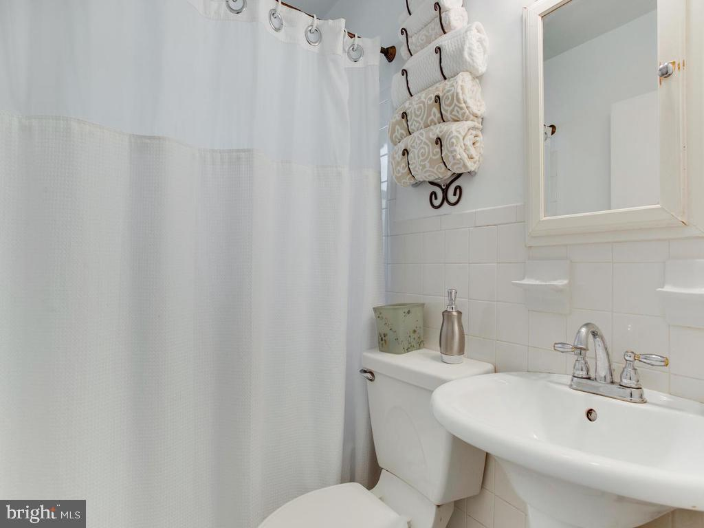 White Bathroom on the 1st floor! - 6808 PICKETT DR, MORNINGSIDE