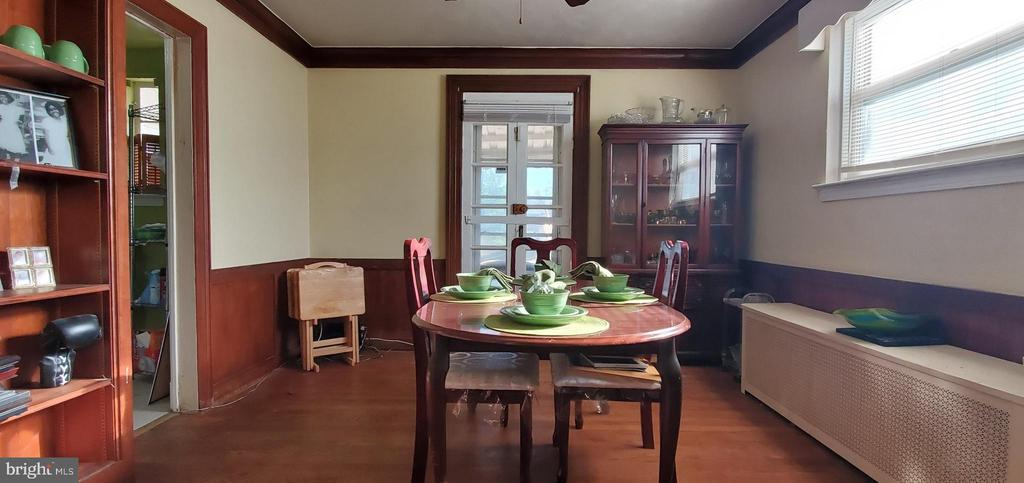Ample dinning room w hdw floors and door to deck - 5319 AMES ST NE, WASHINGTON
