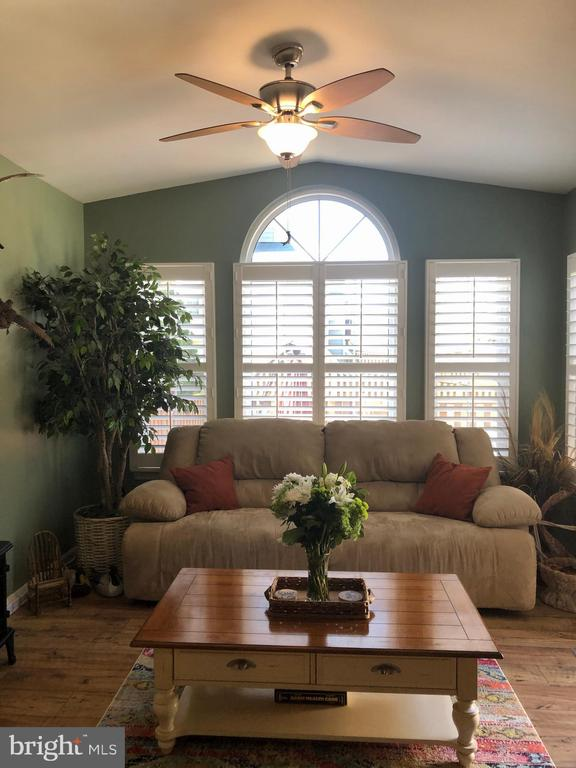 Custom made plantation shutters in the sun room - 191 CONNERY TER SW, LEESBURG