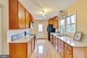New counter tops and updated cabinetry - 7163 MASTERS RD, NEW MARKET