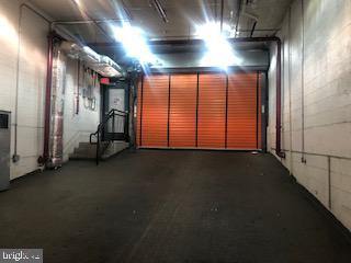 Main garage entrance on O St between 22nd and 23rd - 1414 22ND ST NW #P-13, WASHINGTON