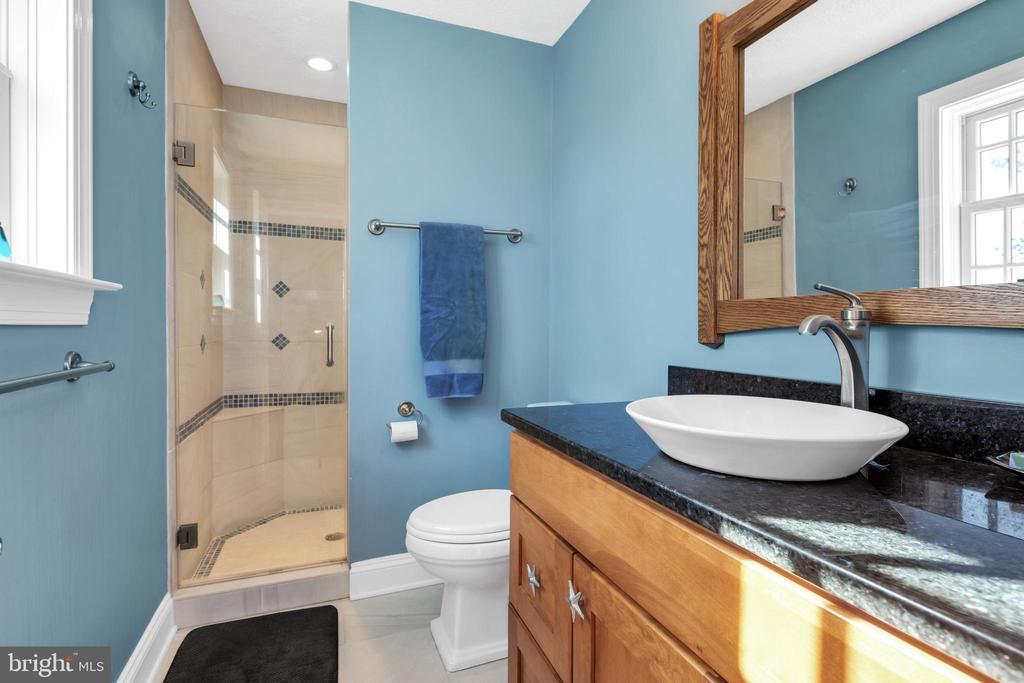 Gorgeous bath boasts radiant heated tile floor - 34332 BRIDGESTONE LN, BLUEMONT