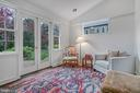 Sunroom has French doors that open to deck - 7007 CONNECTICUT AVE, CHEVY CHASE