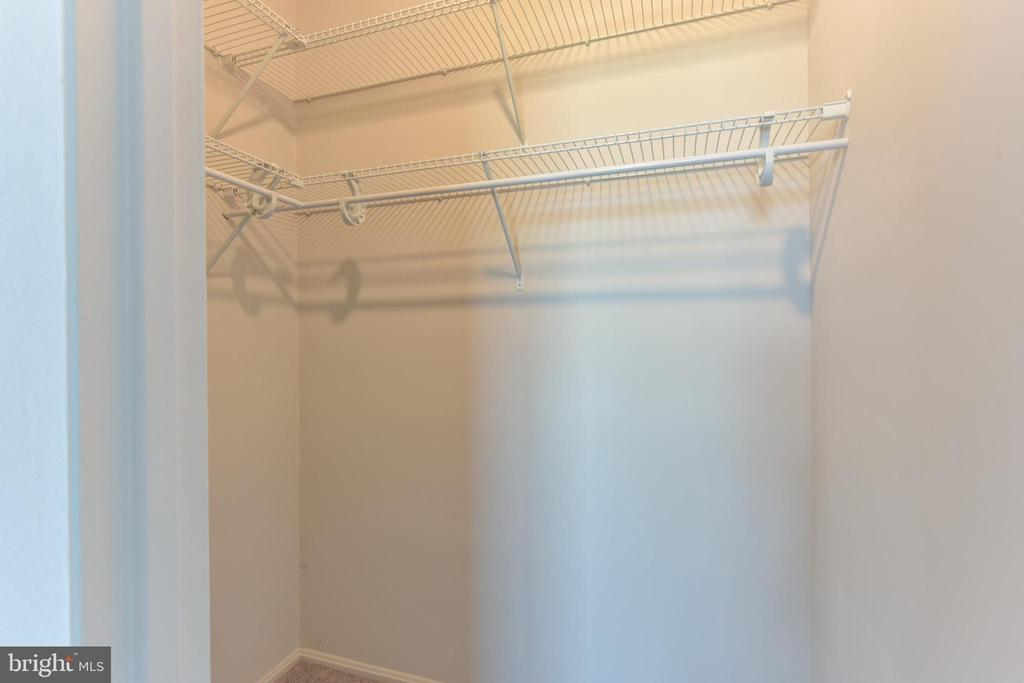 Bedroom 2 closet with new shelving system - 5500 HOLMES RUN PKWY #1210, ALEXANDRIA