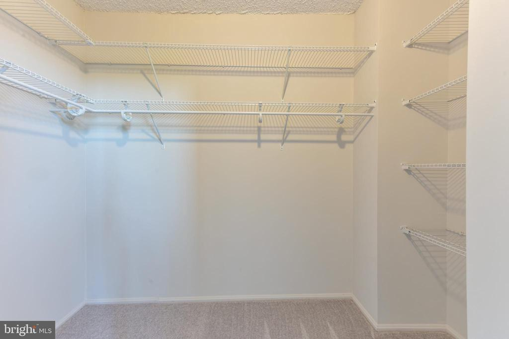 Master walk-in closet with new shelving system - 5500 HOLMES RUN PKWY #1210, ALEXANDRIA