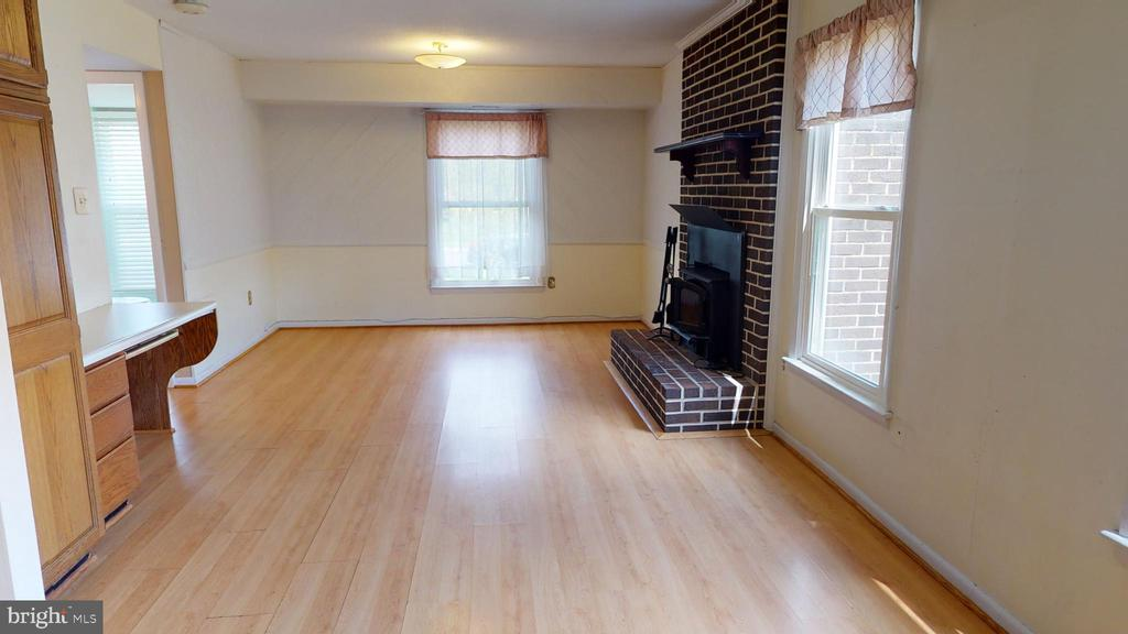 Family room with cozy wood burning fireplace - 12803 SCRANTON CT, HERNDON