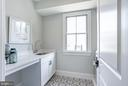 upstairs laundry with sink storage, tile floor - 4856 33RD RD N, ARLINGTON