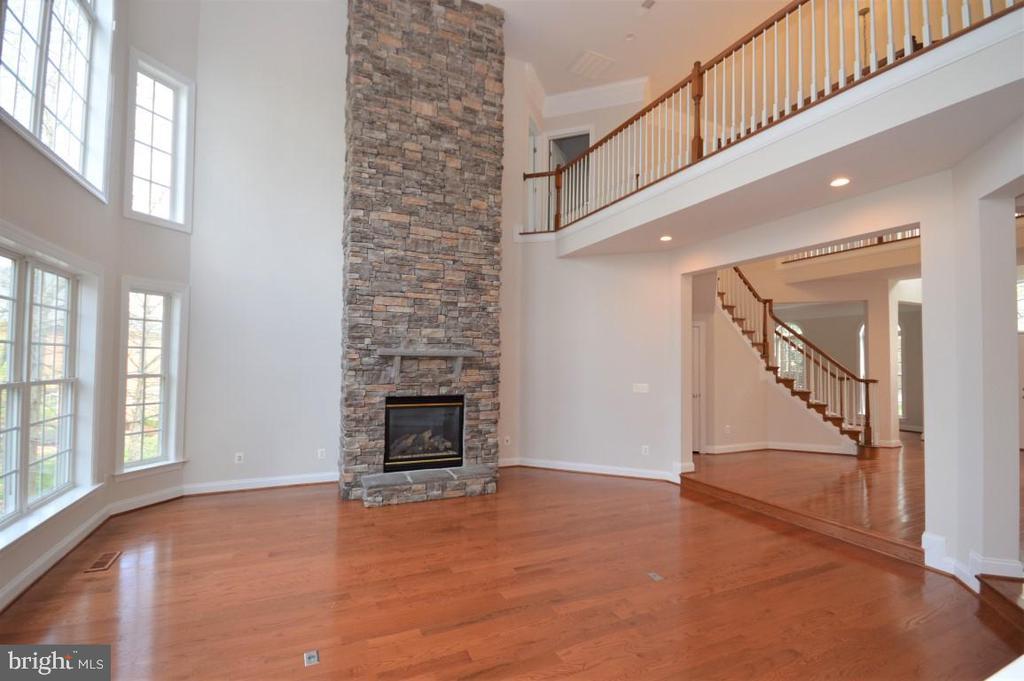 Family Room w/Floor to Ceiling Stone Fireplace - 42764 RIDGEWAY DR, BROADLANDS
