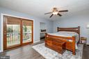 Master Bedroom-Deck overlooking backyard - 1015 MAGOTHY PARK LN, ANNAPOLIS