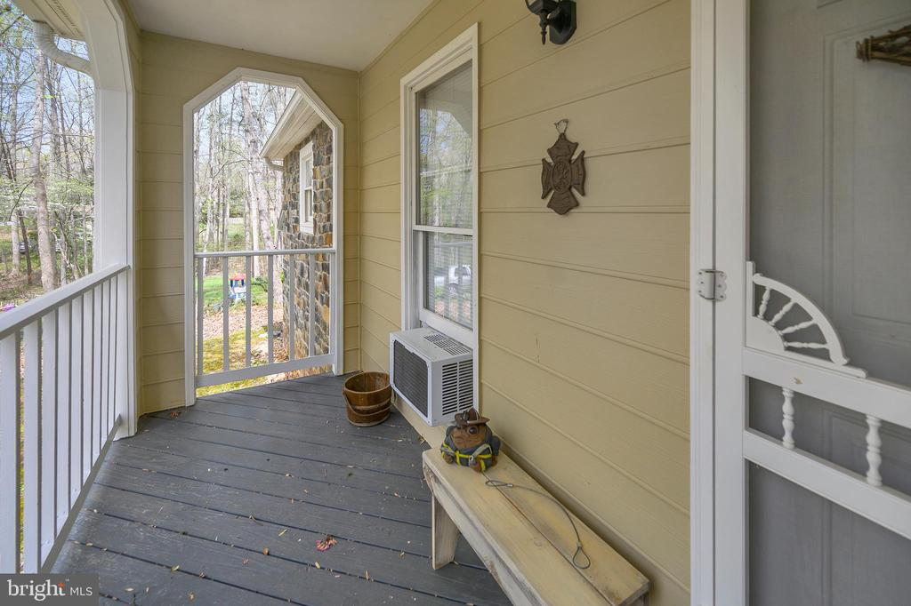 Covered Front Porch sitting area - 11709 WILDERNESS PARK DR, SPOTSYLVANIA