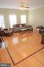 Family room with decorative hardwood flooring - 15 LOTUS LN, STAFFORD