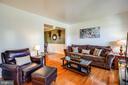 Sun-filled living room adjoins dining space - 6055 PONHILL DR, WOODBRIDGE