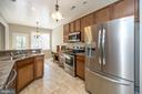Open and bright kitchen with stainless appliances - 623 MT PLEASANT DR, LOCUST GROVE