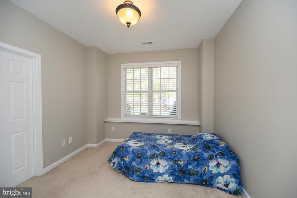 Bedroom number 4 lower level with attached bath - 623 MT PLEASANT DR, LOCUST GROVE