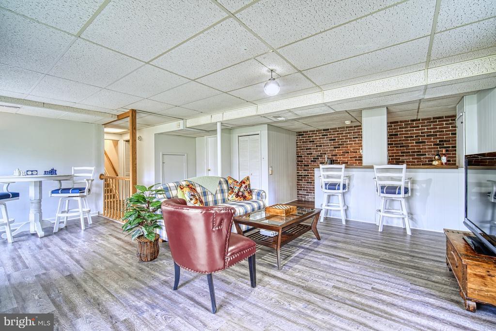 Open recreation room with new vinyl plank flooring - 11610 HENDERSON RD, CLIFTON