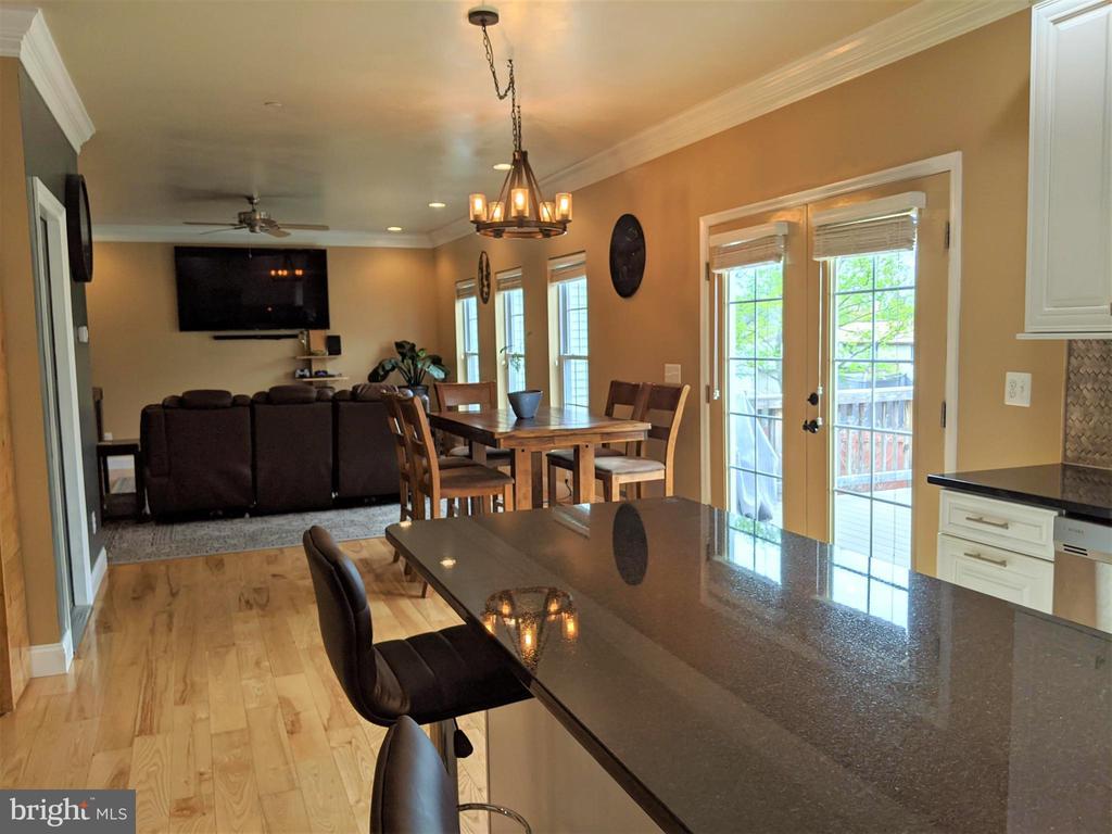 Kitchen to Family Room & Deck - 9301 OLD SCAGGSVILLE RD, LAUREL