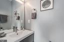 Half bath on the first floor. - 5700 BLAIR RD NE, WASHINGTON