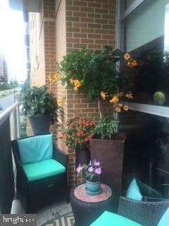 Private outdoor Balcony. - 12025 NEW DOMINION PKWY #103, RESTON