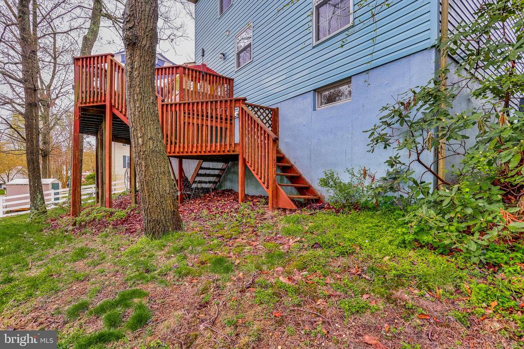 Stairs to Rear Deck from Yard - 7924 BUTTERFIELD DR, ELKRIDGE