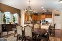 Kitchen open to formal dining area - 8733 ENDLESS OCEAN WAY #32, COLUMBIA