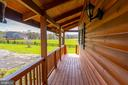IMAGINE RELAXING ON THIS FRONT PORCH - 34876 PAXSON RD, ROUND HILL