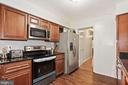 Kitchen with SS appliances. - 3005 SEVEN OAKS PL, FALLS CHURCH