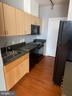 Kitchen with black appliances and cabinets - 1414 BELMONT ST NW #309, WASHINGTON