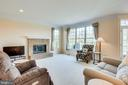 Family room features gas fireplace - 19862 LA BETE CT, ASHBURN