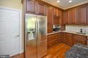 Kitchen view/second sink/garage access door - 42 LIGHTFOOT DR, STAFFORD