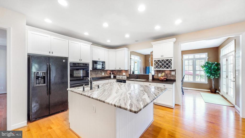 Kitchen with wood floors - 31 CRAWFORD LN, STAFFORD