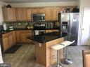 Kitchen with Stainless Steel appliances - 7761 VALLEY OAK DR #208, ELKRIDGE