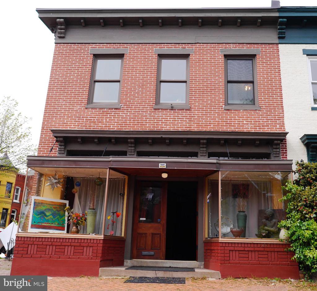 From the large bricked entry to the home entrance - 900 SOUTH CAROLINA AVE SE, WASHINGTON